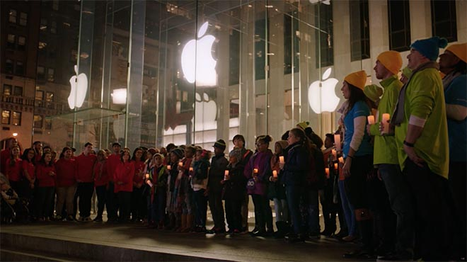 Microsoft staff sing Peace on Earth outside Apple Store in Fifth Avenue, New York