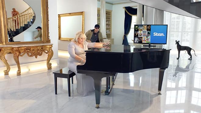 Rebel Wilson in Stan commercial with piano