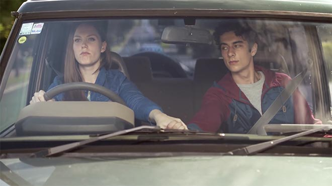 NZTA Drive Phone Free commercial with driver and passenger holding hands
