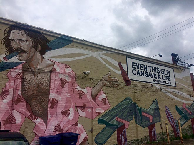 The World's Biggest Asshole mural associated with Donate Life commercial