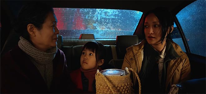 Family in back seat of taxi in Apple Daughter short film