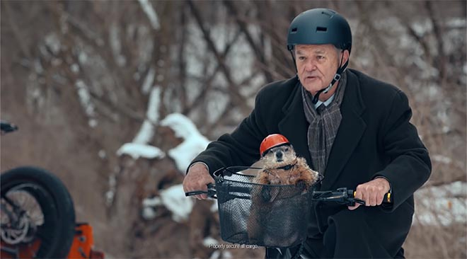 Bill Murray as Phil Connor on bike in Jeep Groundhog Day commercial