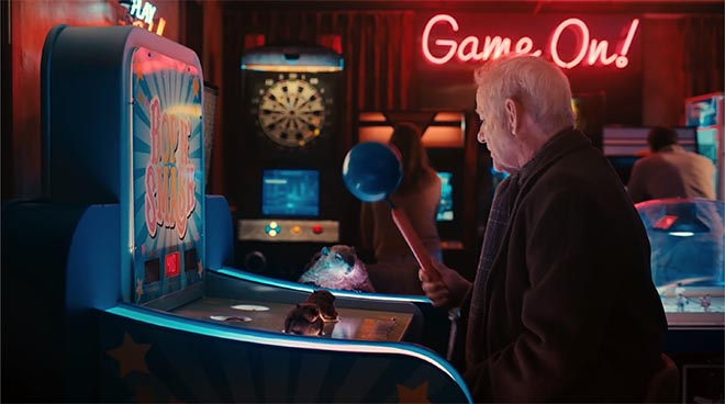 Bill Murray playing Whack a Mole in Jeep Groundhog Day commercial