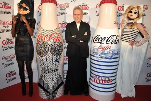 Jean Paul Gaultier with Diet Coke Night and Day bottles, models with puppet faces