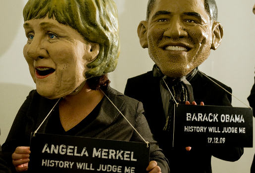 Merkel and Obama in Oxfam History Will Judge Me stunt