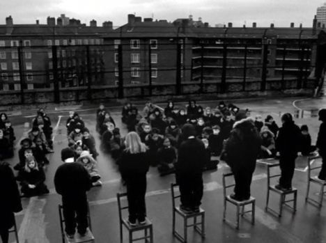 Faithless Photo of Children lined up on chairs in school yard
