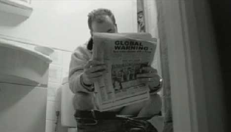 Man reads newspaper with global warming headline in Proper Education music video