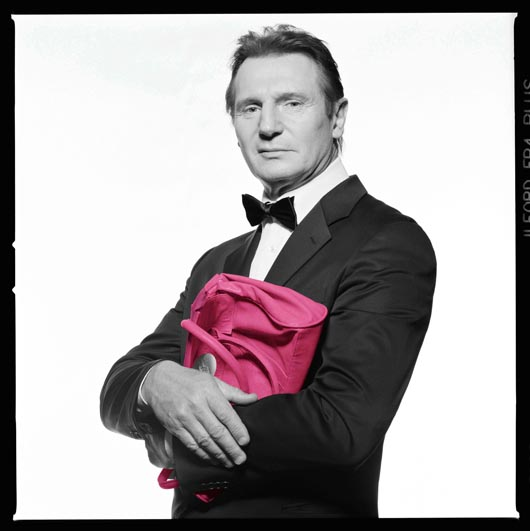 Liam Neeson with Pink Handbag for Cancer Research UK