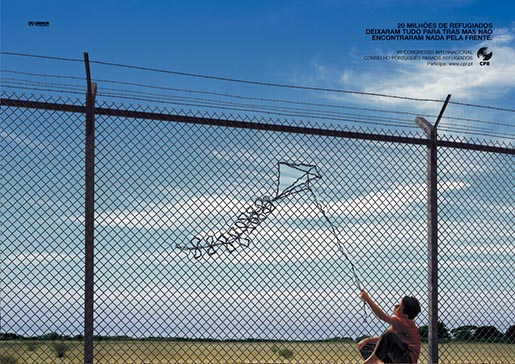 Refugee imagines a kite in the detention camp fence