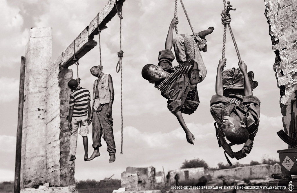 Child soldiers playing by a public hanging in Amnesty International