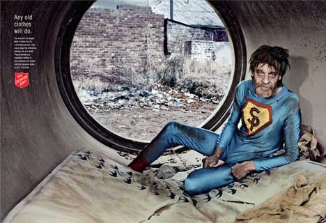 Homeless man wears superman costume in Salvation Army print ad