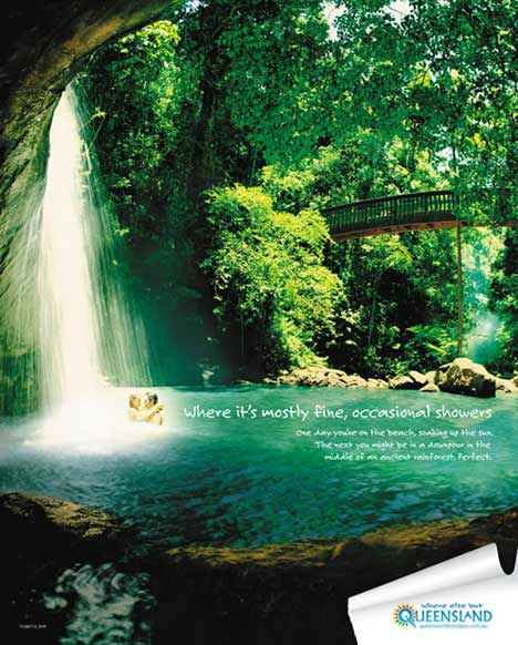 Couple swim under waterfall in Tourism Queensland print ad
