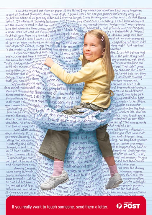 Child receives a hug through a letter in Australia Post print ad