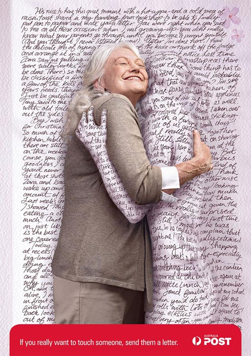 Mum receives a hug through a letter in Australia Post print ad