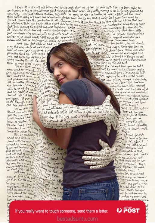 Couple hug through a love letter in Australia Post print ad