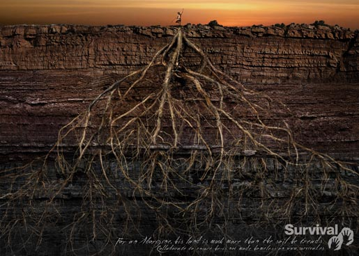 Aborigine man stands over roots in Survival advertisement