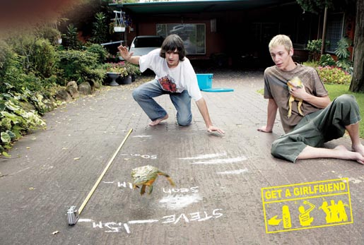 Boys measure a frog's jump