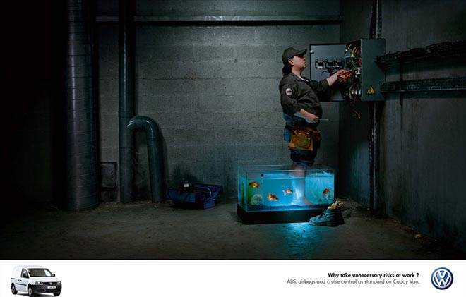 Electrician standing in aquarium in Volkswagen advertisement