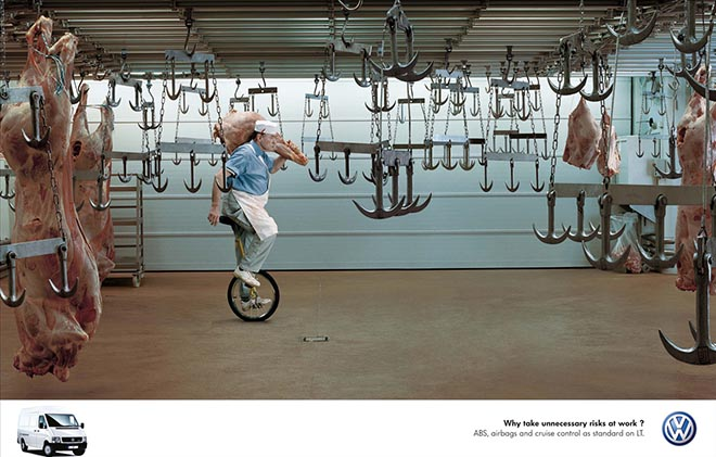 Butcher rides on unicycle in Volkswagen advertisement