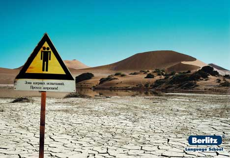 Desert warning sign in Berlitz print advertisement