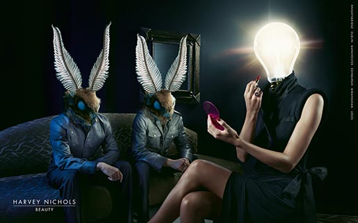 Moth heads attracted to woman with light bulb head