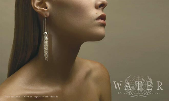 Woman wearing water earring for World Water Decade