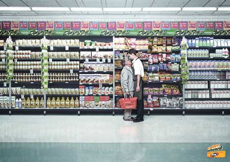 Shopper and attendant stand close in PK Gum print ad