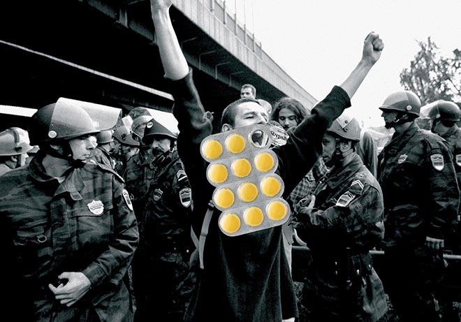 Protester in Strepsils print advertisement