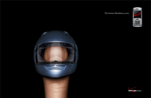 Helmeted thumb in Verizon Blackberry print advertisement