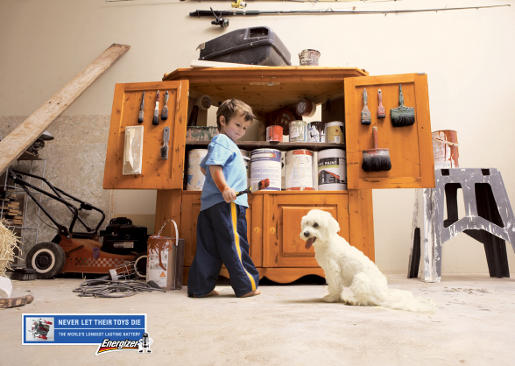 Dog and paint brush in Energizer Lithium batteries print ad
