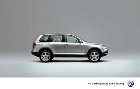 VW Touareg climbing with a suit