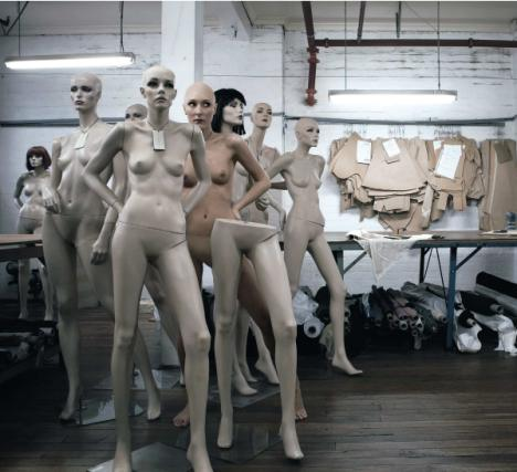 Woman posing among mannequins for British Council competition