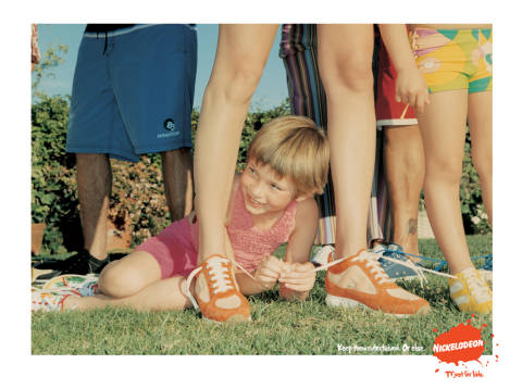 Shoe laces tied in Nickelodeon print ad