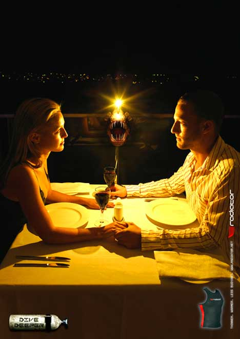 Couple dining to the light of a deep sea fish