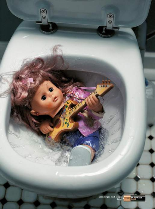 Toy guitar lasts longer in Duracell print advertisement