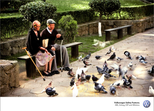 Volkswagen Crash Test Dummies in park feeding pigeons