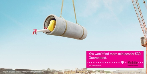 Woman looks inside pipe in T-Mobile print ad