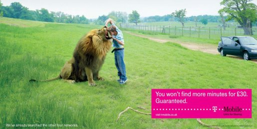 Man looks inside lion's mouth in T-Mobile print ad