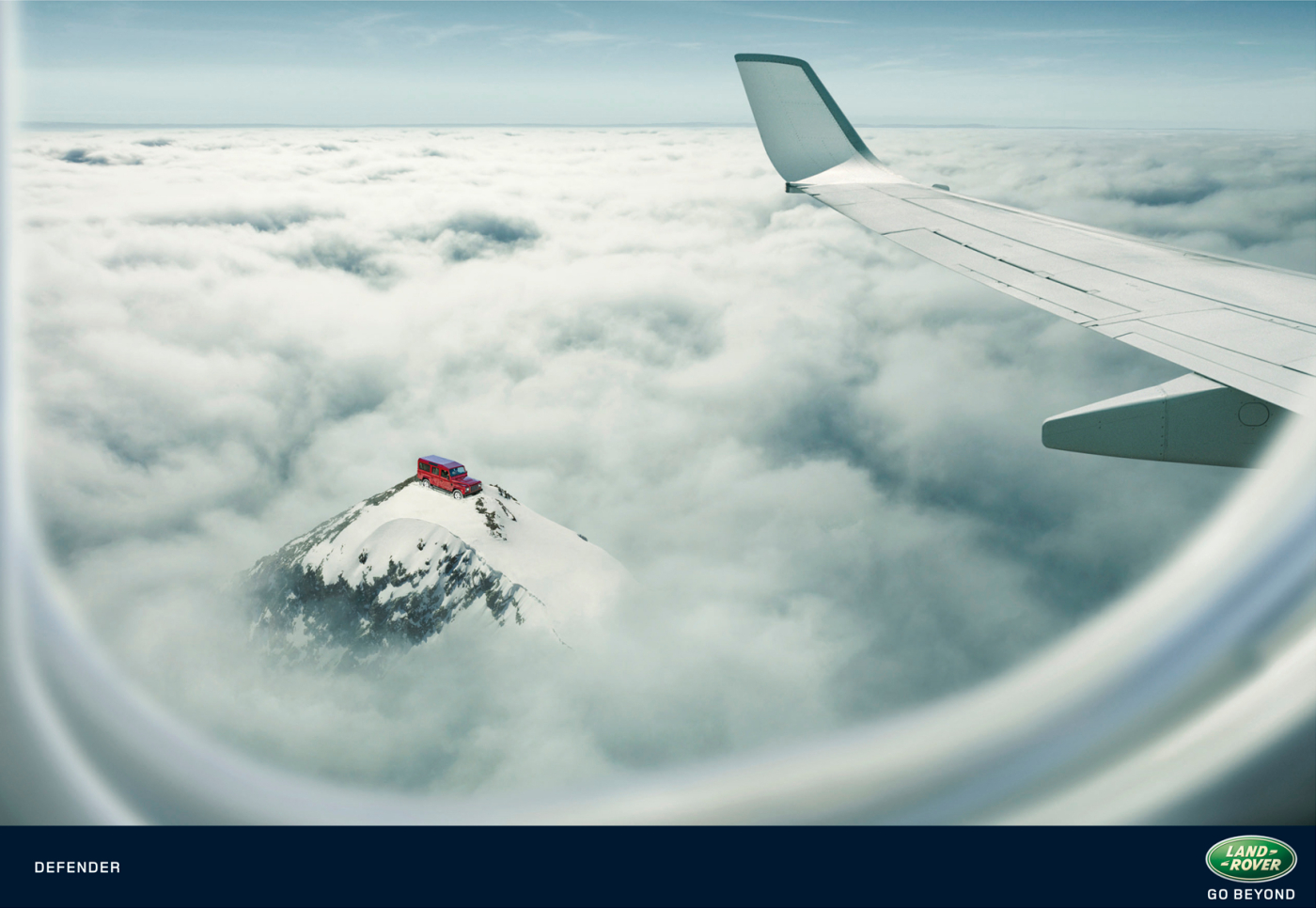 Land Rover Defender from above the clouds in print advertisement