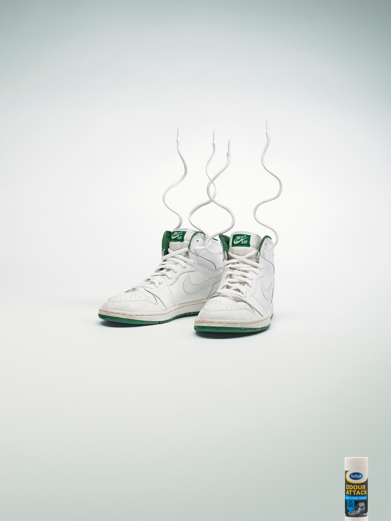 Nike shoes with laces on end in Scholl print advertisement