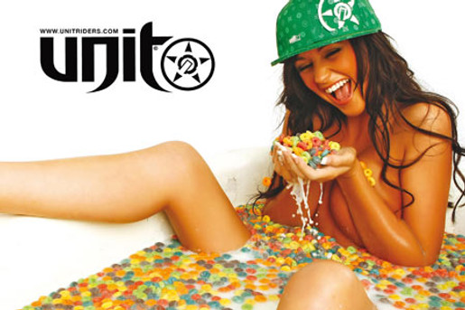Model in bath of milk and fruitloops wears Unit cap