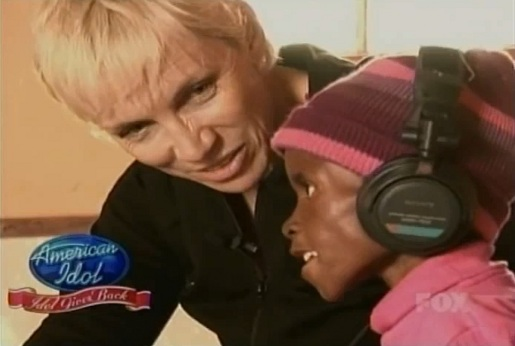 Annie Lennox and child with HIV AIDS and pneumonia