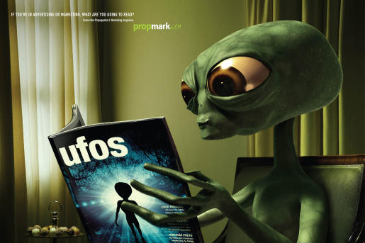 Alien reads UFOs magazine in Propmark advertisement