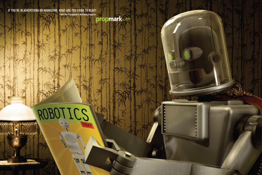 Robot reads Robotics magazine in PropMark advertisement