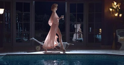 Eva and Brian Atwood In The Pool
