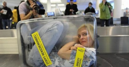 Amnesty Woman in Suitcase